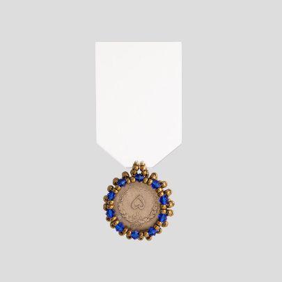 تصویر  مدال آینه و سکه ی 5 ریالی