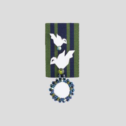 تصویر مدال بوستان سبز و سرمه ای دو پرنده