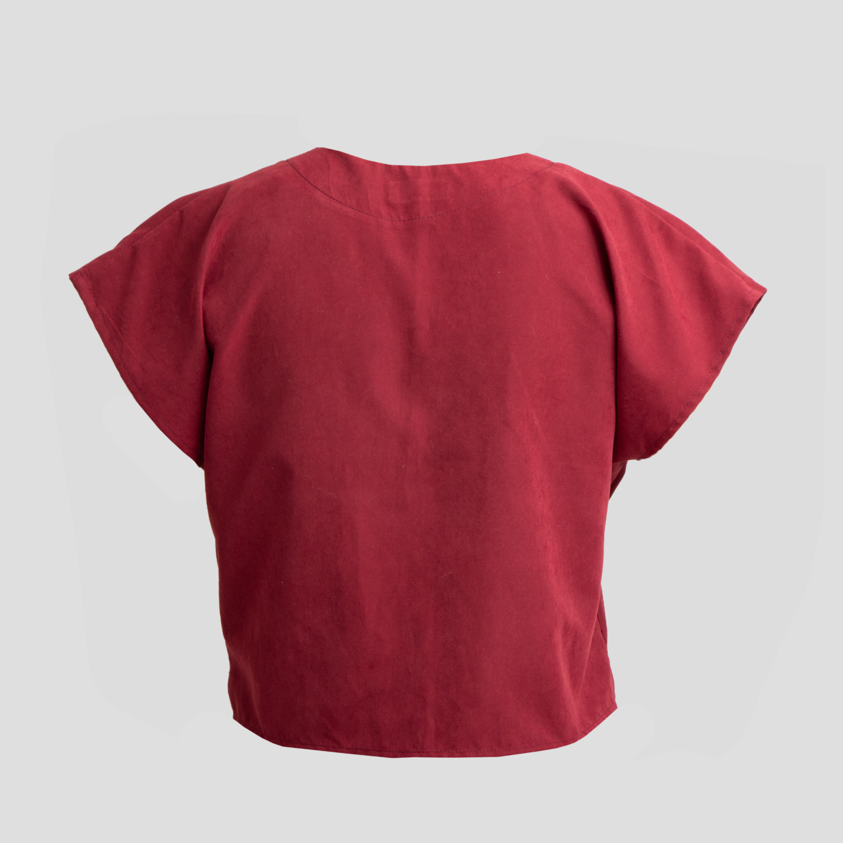 Picture of dark red top with large pockets