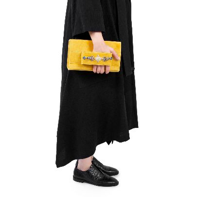 Picture of yellow suede bag