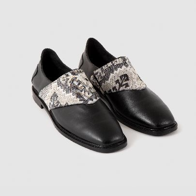 Picture of black leather shoe with fabric