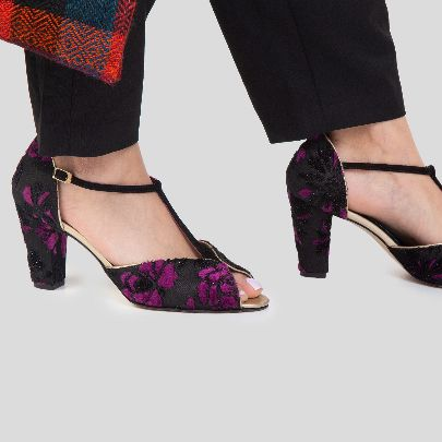 Picture of black high heels with pink flowersw