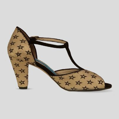 Picture of beige high heels with black star