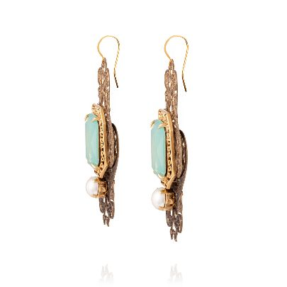 Picture of metal earrings with green stone