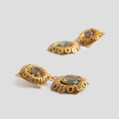 Picture of golden earrings with leather