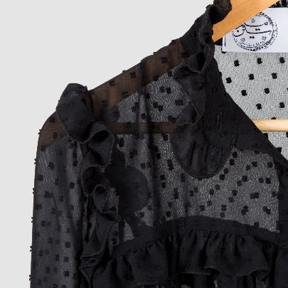 Picture of black blouse with dots