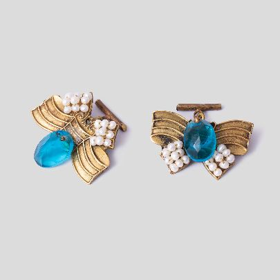 Picture of bow tie cuff links with blue stone