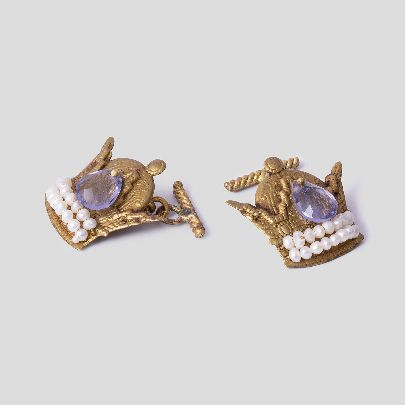 Picture of crown cuff links with purple stone