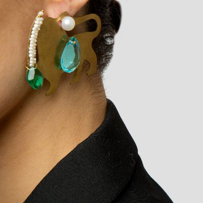 Picture of lion earrings with blue stone