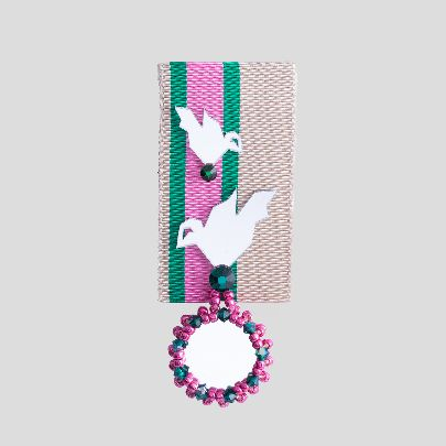 Picture of pink brooch with two birds