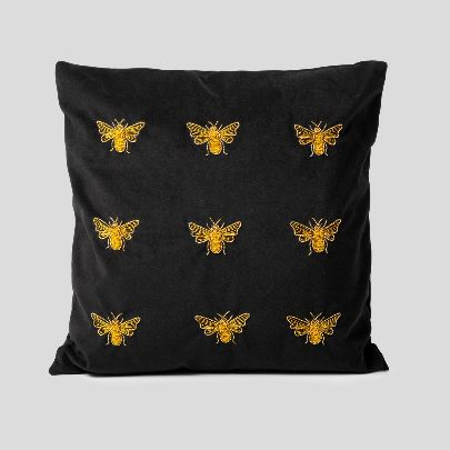 Picture of gold moth embroidered cushion