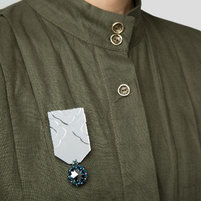 Picture of Mirror and stone brooch